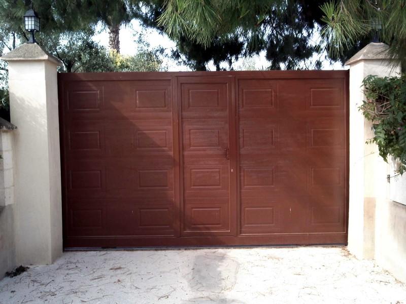Correderas construcciones met licas cerrisan for Puertas correderas de forja
